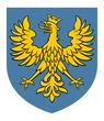 Herb przedstawia w polu błękitnym złotego orła górnośląskiego w koronie z czasów ostatniego księcia opolskiego Jana II Dobrego.